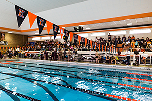Kalamazoo College Natatorium swimming lanes with crowd in stands for the K vs Alma meet.